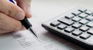 Accountant with pen and calculator